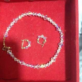 swarovski (class A) bracelet (used twice) and earrings ( new) i have 3 pairs of earrings. but only 1 pair i will sell
