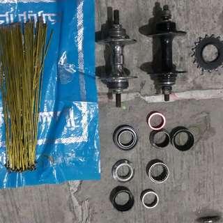 2 Rear fix hubs, 62 spokes, etc
