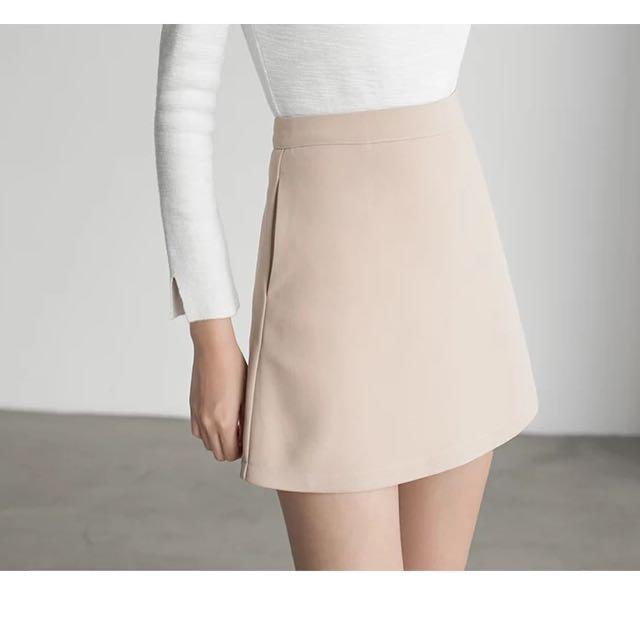 溫柔杏色雙口袋A字裙短裙