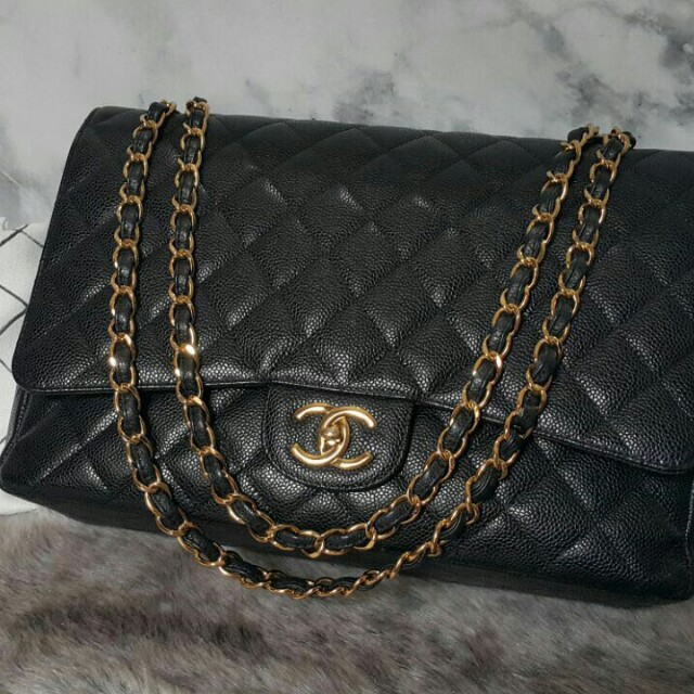 Chanel Maxi Double Flap Quilted Caviar Bag