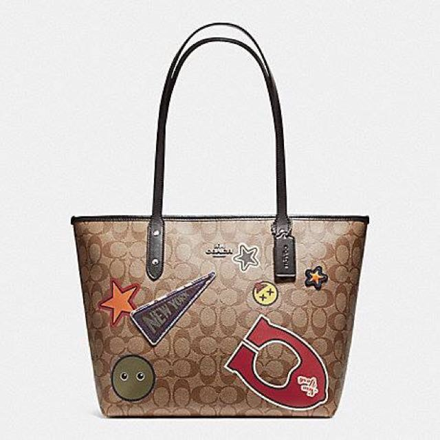 ... discount code for coach city zip tote in signature coated canvas with  varsity patches womens fashion e7aa43bf4f23e