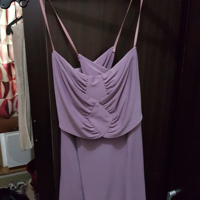 Folded and hung violet top
