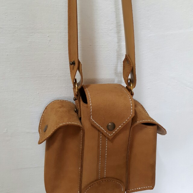 Genuine Leather double sided front sling bag.