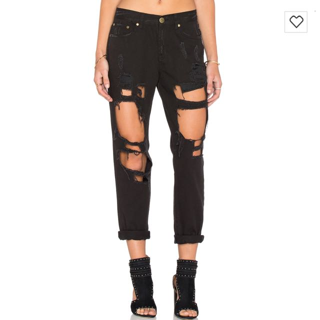 Reverse distressed jeans