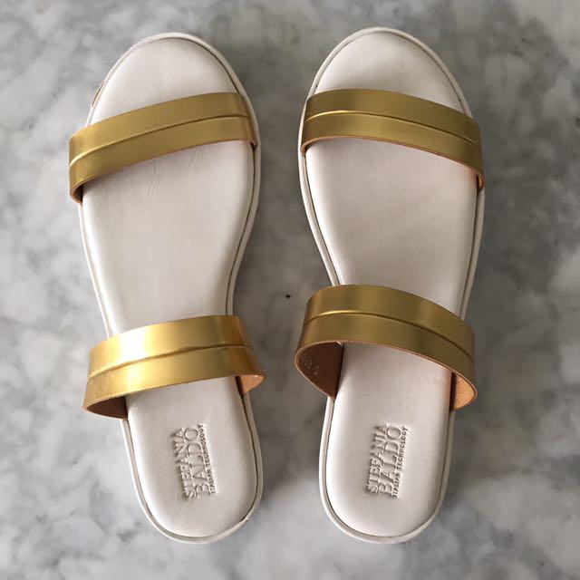 White & gold sandals