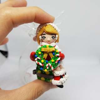 Christmas girl in clear glass angel shape made by polymer clay