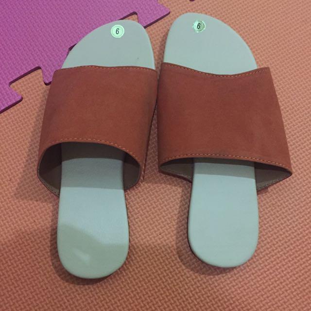 Orange flat sandals