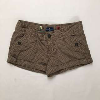 Brown houndstooth shorts, size 6