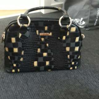 Black and gold hand bag