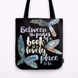 Society6 Between the pages of a book is a Lovely place to be Tote Bag