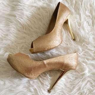 Victoria gold heels