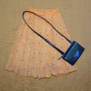 Orange polka pleated skirt