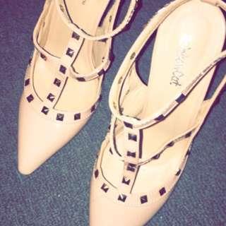 Nude pink studded heels