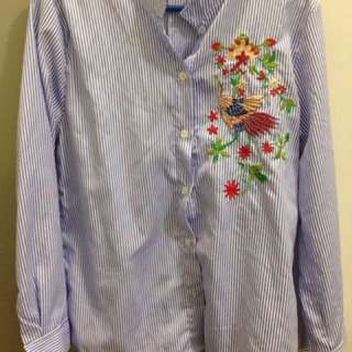 striped top with bird and flower embellishments