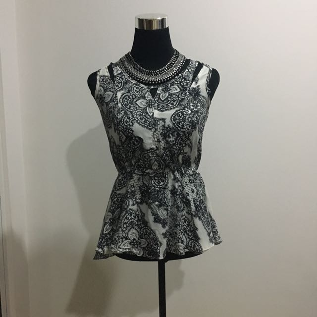 The Ramp Peplum Sleeveless Blouse Top