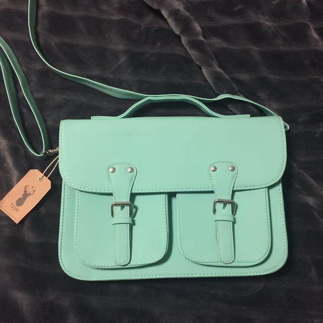 TYPO turquoise clutch