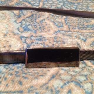 Pewter colour metal stretch belt