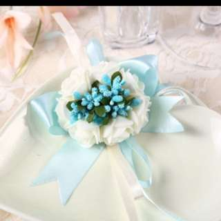 Beautiful blue floral hand wedding corsage