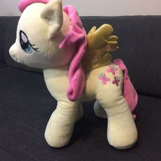 Cute yellow with pink color Pony