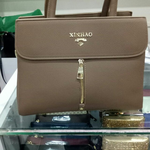 Tas Brown XinHao