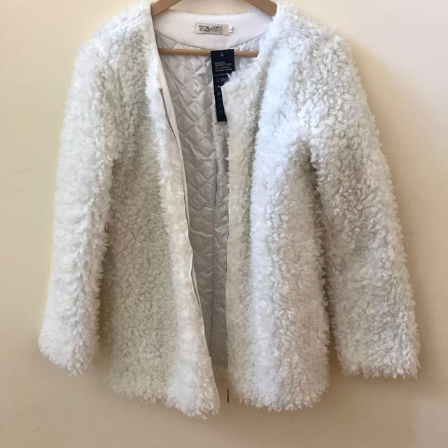 white fuzzy/faux fur lined jacket