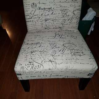 Chair cream black writing