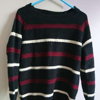 Red and white striped black knit