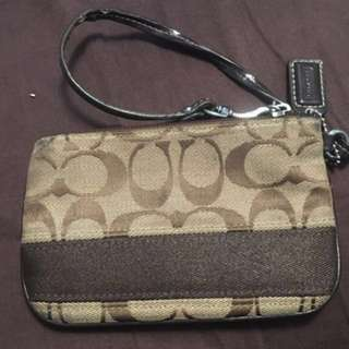 Brown coach monogram wristlets