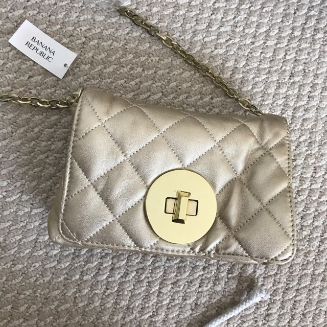 Quilted gold cross body with gold hardware - banana republic