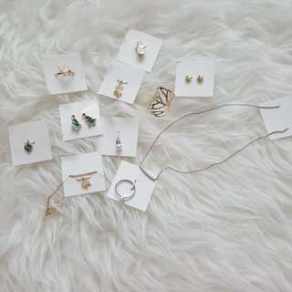 Assortment of jewellery  pendants rings earrings and necklace