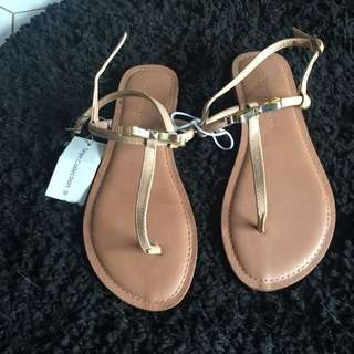BNWT metal bow sandals