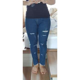 ripped dark jeans with rubber waist size S