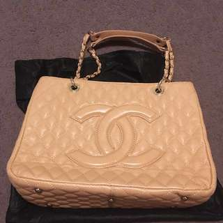 Tan coloured handbag with gold hardware