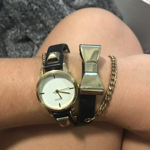 black and gold bow watch
