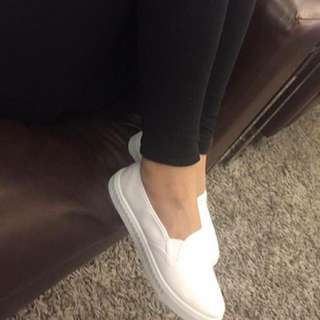 white slip on canvas shoes