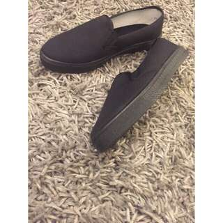all black slip on canvass shoes