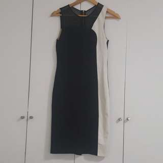 ABS Black & White Cocktail Dress with mesh panel and gold zipper detail. SIZE SMALL