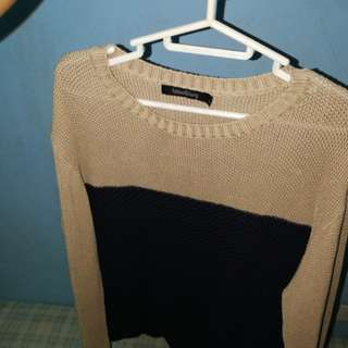 Folded and Hung Knitted Sweatshirt