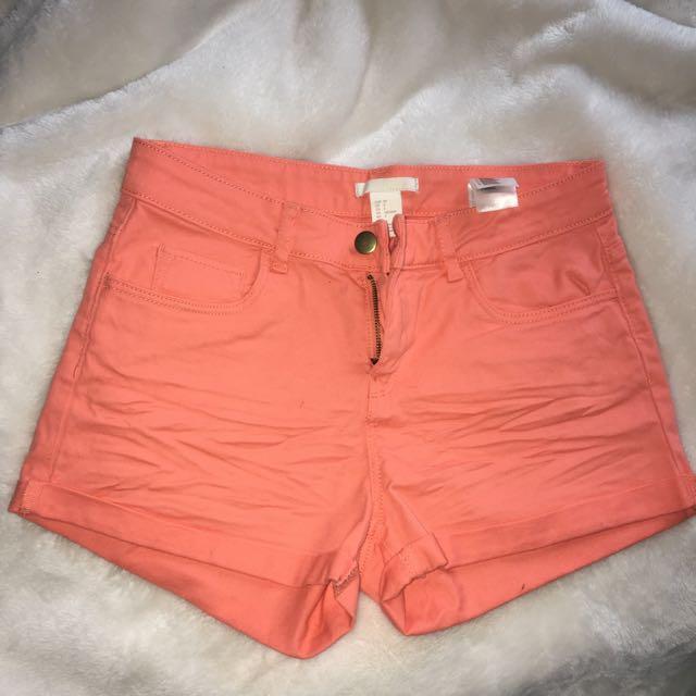 Orange ish pink shorts
