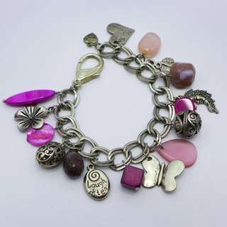 Charm bracelet with pink precious stone and glass beads