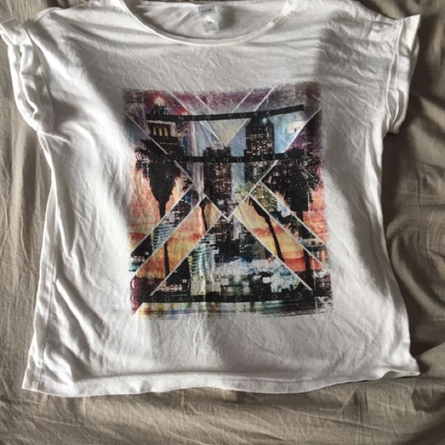 White top with city scape print