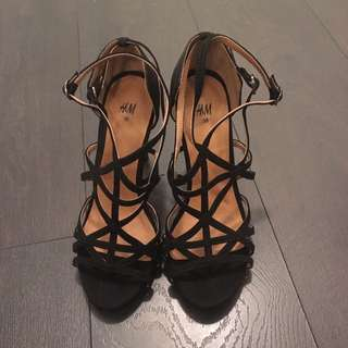 Black cage-style heels