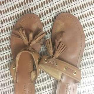 Coach tan slip on tassels, Size 8