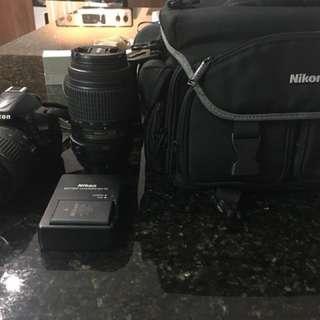 Nikon D3100 DSLR Camera with Telephoto Lens & Bag