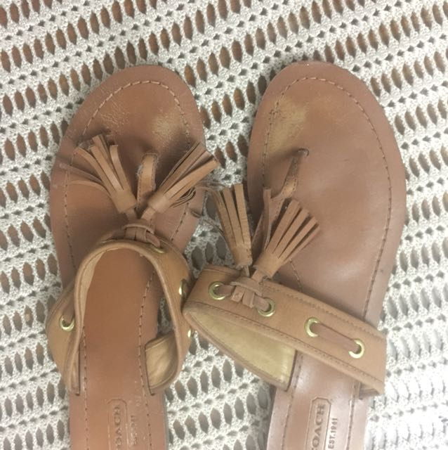 Coach tan slip on tassels, Size 8