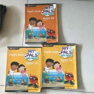 assorted primary 2 books, math music and art