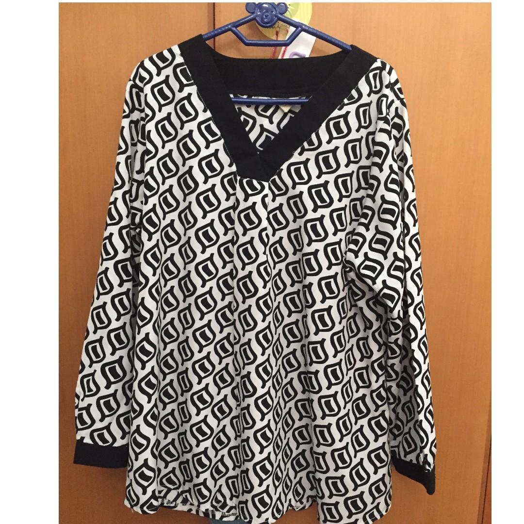 blouse motif hitam putih
