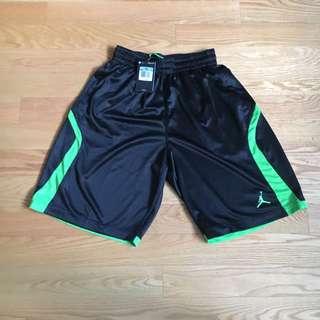 Nike Basketball green and black shorts