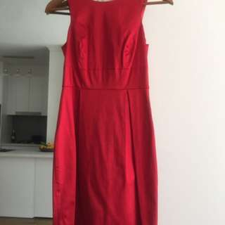 Red sateen dress with low v back and bow