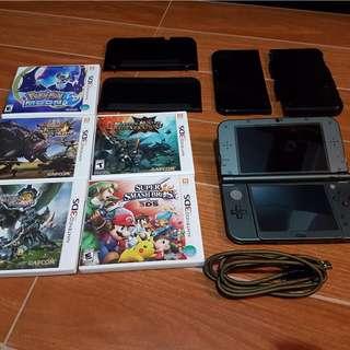 N3DSXL + 5 games + 2 cases